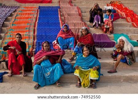 VARANASI - JANUARY 15: Unidentified hindu pilgrims dry their saris after bathing in the sacred Ganges river at Dashashwamedh ghat on January 15, 2010 in Varanasi, State of Uttar Pradesh, India