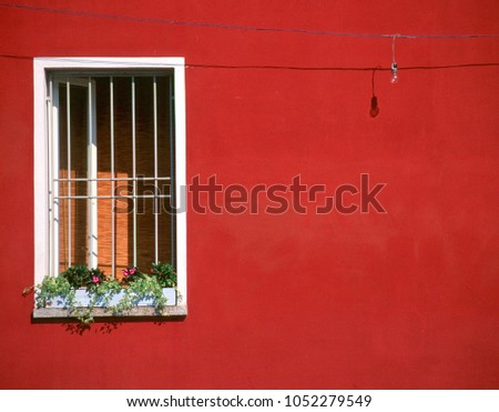 varenna  italy window with red...