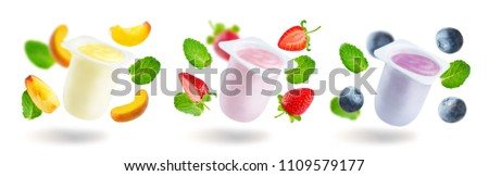 Variation of fruit yogurts: strawberry, blueberry and peach isolated