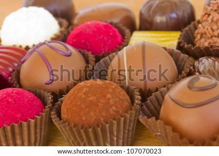 variations of chocolated sweet pralines close up
