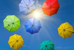 varicoloured umbrella fly in a sky on sparkle sun background