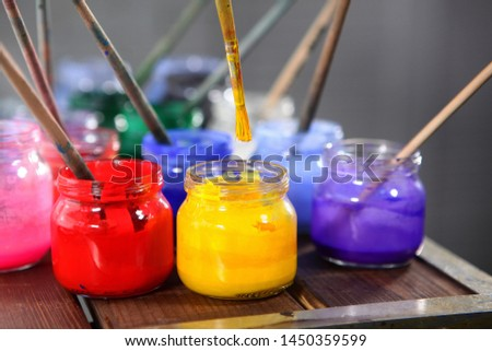 Varied colors of paints for painting in jars close up. The range of colors. Concept hobbies and hobbies.