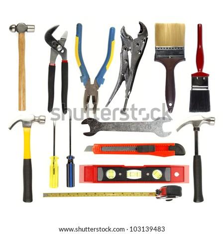 Varied tools on plain background
