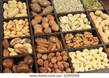 Varieties of nuts: peanuts, hazelnuts, chestnuts, walnuts, cashews, pistachio and pecans. Also sunflower and pumpkin seeds. Food and cuisine.