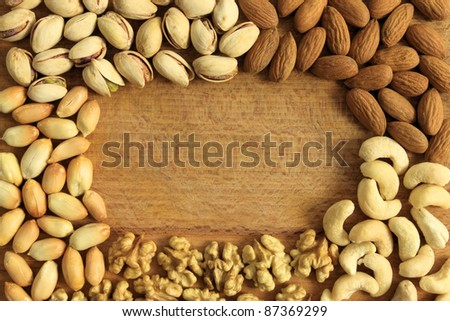 Varieties of nuts: peanuts, walnuts, cashews, pistachio and almonds. Food and cuisine.