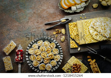 Varieties of traditional candies and sweets to celebrate Prophet Muhammad's birthday event, Top view with copy space.