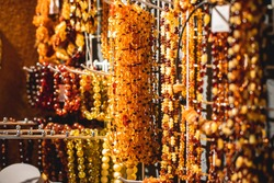 Variety assortment of souvenirs made of amber, traditional tourist souvenirs and gifts from Kaliningrad, Russia, in local vendor souvenir shop