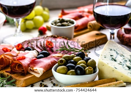 Variety food on table, wine snack set, olives, cheese and other appetizer, italian antipasti on plate Сток-фото ©