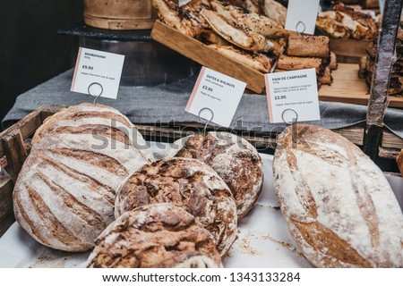Variety of artisan bread on sale at a street market, selective focus.
