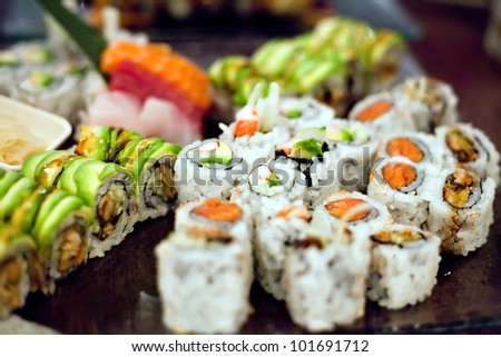 Variety of authentic sushi rolls on a platter. Shallow depth of field.