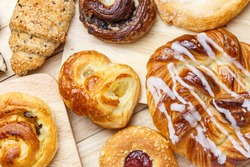 Variety of bakery products on wood plate background