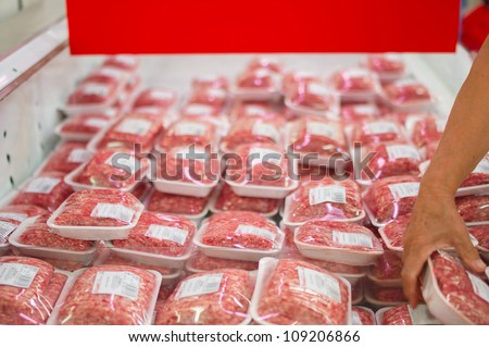 Variety of beef forcemeat in boxes in supermarket