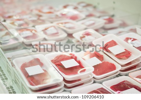 Variety of beef slices in boxes in supermarket