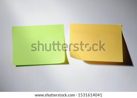 Variety of blank note, stick note paper, isolated on grey wall #1531614041