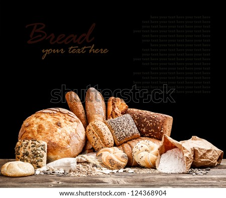Variety of bread on black background