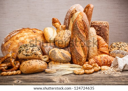 Variety of bread on old wooden table