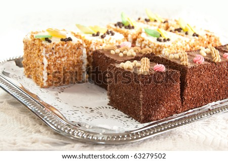 Variety of cakes on a silver platter