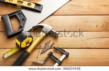 variety of carpentry tools on wood planks with copy space #306035438
