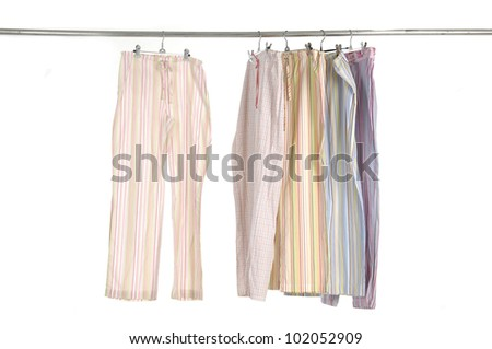 Variety of casual fashion leisure trousers on a hanger