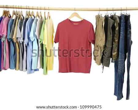 Variety of casual shirts and jeans on wooden hangers