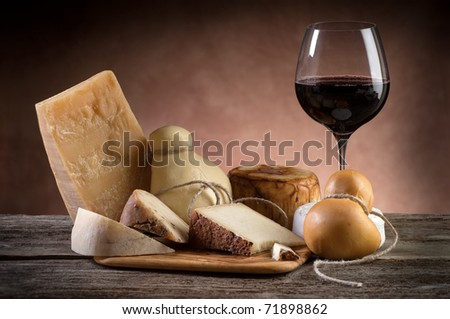variety of cheese and red wine