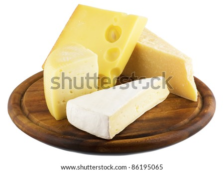 variety of cheese on wood