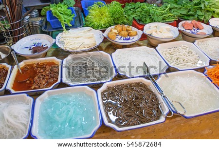 Variety of Chinese dishes at the market, Chinese street food concept.
