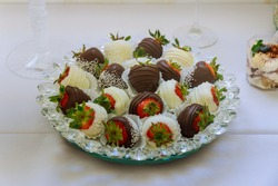 Variety of chocolate dipped strawberries in a plate. Valentines day dessert.