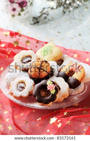 Variety of Christmas cookies on a festive tablecloth