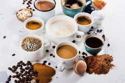 Variety of coffee in ceramic cups. Flat lay style. Time for coffee concept. Space for text