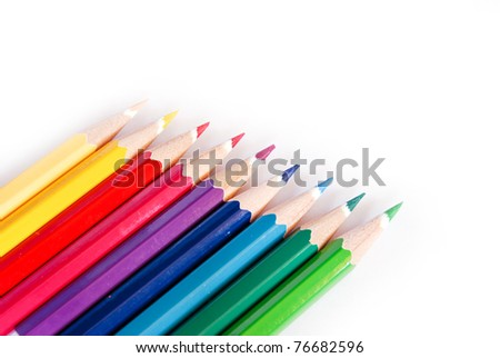 variety of color pencils isolated on white background
