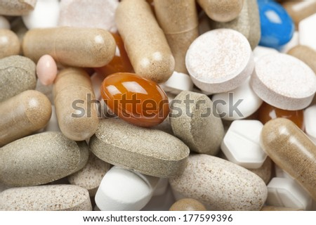 variety of colorful pills and tablets, close up