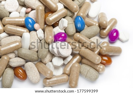 variety of colorful pills and tablets on white background