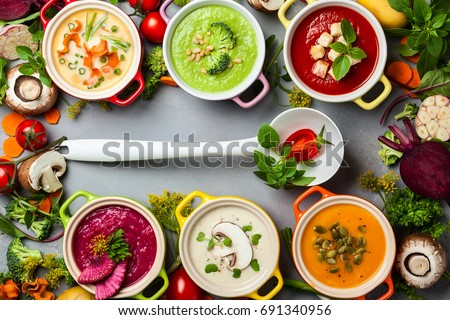 Shutterstock Variety of colorful vegetables cream soups and ingredients for soup. Top view. Concept of healthy eating or vegetarian food.