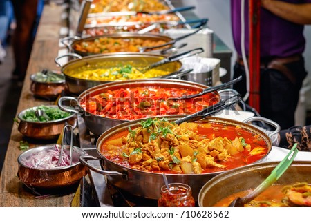 Variety of cooked curries on display at Camden Market in London #710628562