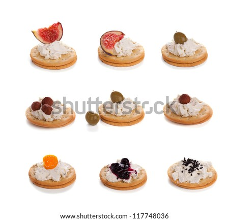 Variety of cracker canapes with cream cheese