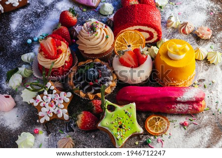 Variety of delicious confectionery products. A mix of chocolate mousse, eclair cakes, Cupcakes and Shu cakes for a candy bar, or a pastry shop showcase presentation.