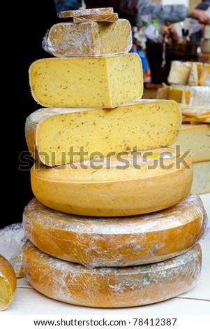 Variety of different cheeses pile on market