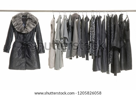 Variety of different clothes for females on hanging