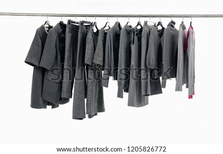 Variety of different gray clothes for females on hanging