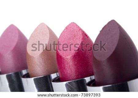 Variety of different lipsticks isolated on a white background.
