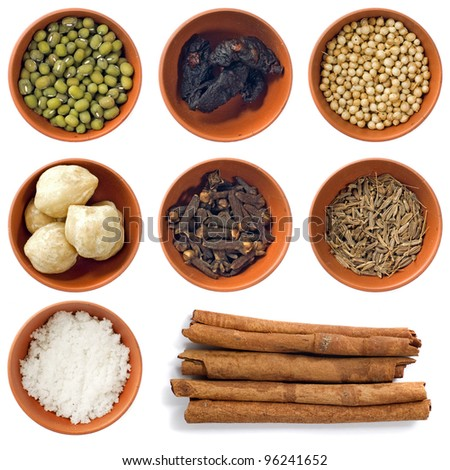 Variety of different spices in bowls for seasoning. Isolated over white background - stock photo