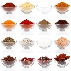 Variety of different spices in glass bowls for seasoning, isolated on white background
