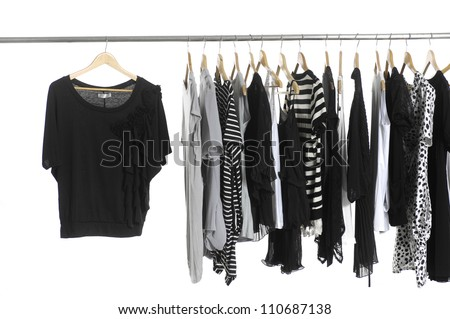 Variety of fashion clothing hanging on hangers