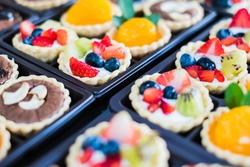 Variety of Fresh fruit pie tart, selective focus