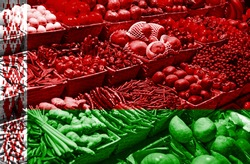 Variety of fresh fruits and vegetables against national flag of Belarus