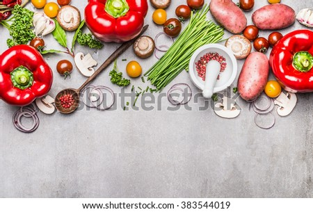 Variety of fresh organic vegetables and seasoning for tasty vegetarian cooking with mortar, pestle and wooden spoon on gray concrete texture background, top view, banner. Healthy lifestyle concept.