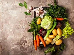 Variety of fresh raw vegetable ingredients for cooking of vegetable soup or stew. Autumn vegetable still life on rustic vintage background. Top view