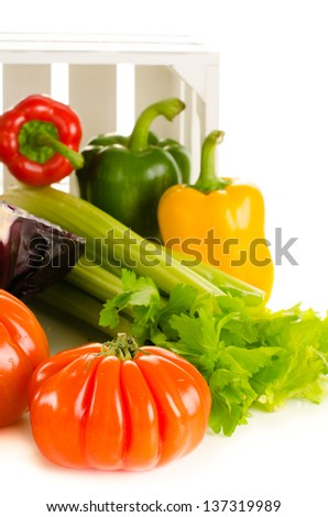 Variety of fresh vegetables on white background