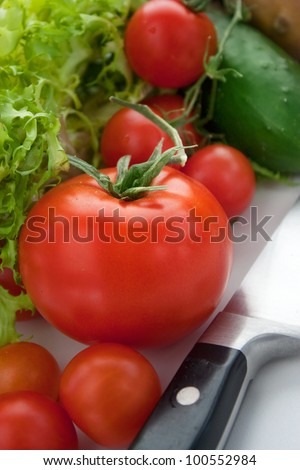 Variety of fresh vegetables. Vegetables background with kitchen knife